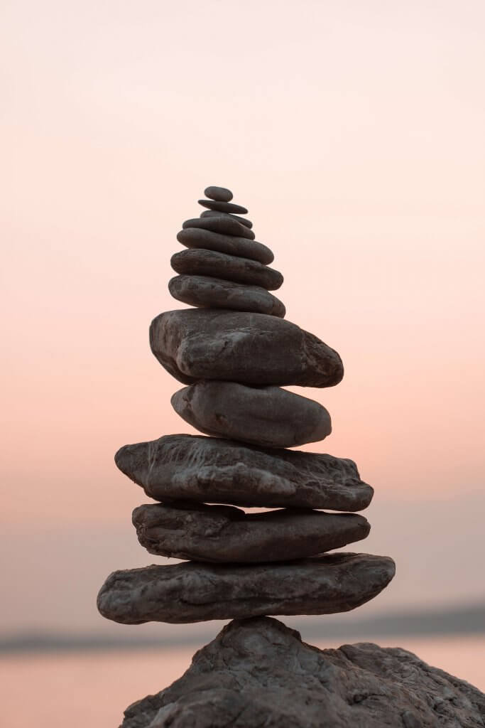 Stacked rocks in Chester symbolising calming hypnotherapy
